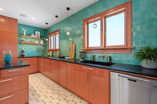 A dramatic Cle' Zellige tile wall tastefully infuses the open space with another layer of color.