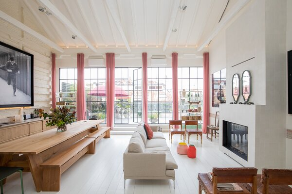 """The home's grand sense of scale becomes immediately apparent once past the foyer, with the primary living spaces offering extraordinary height.  """"This completely open space with maximum cubic capacity is not usual in Madrid,"""