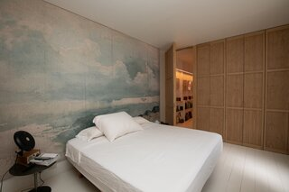 A peek at one of the home's two bedroom suites, which features a custom mural and wardrobe.