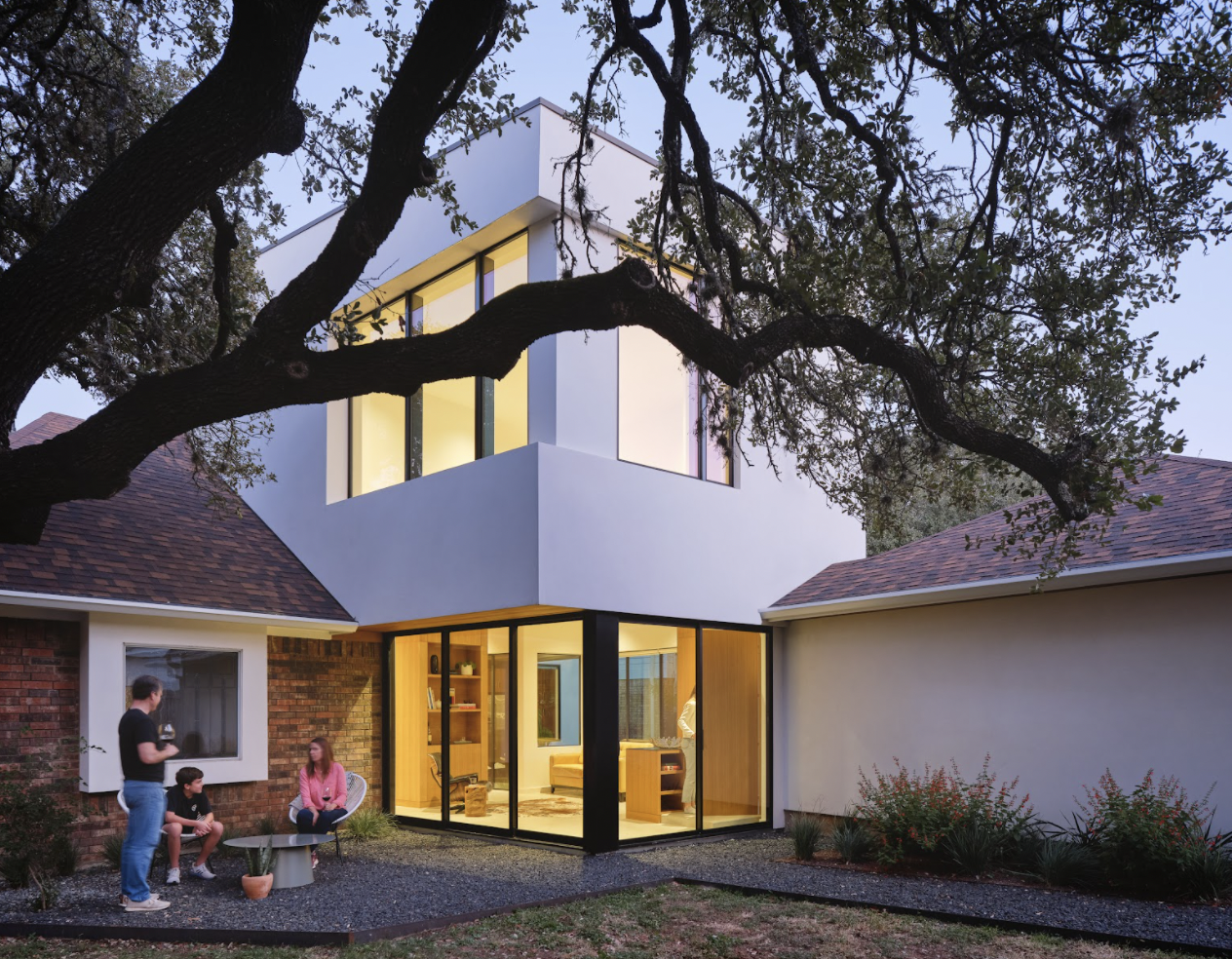 The addition houses a private office, a sitting area, a mud room, and a powder room.  Photo 3 of 9 in This Striking Addition in Austin Is Defined by Clean, Discrete Geometry from Ames House by Matt Fajkus Architecture