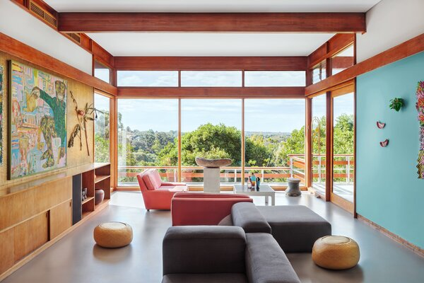A vintage Kartell table and seating fills the living area.