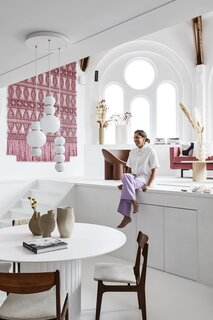 """The pink sofa is joined by a Driade Roly Poly lounge chair. """"I just love the quirky design,"""" Milla says."""