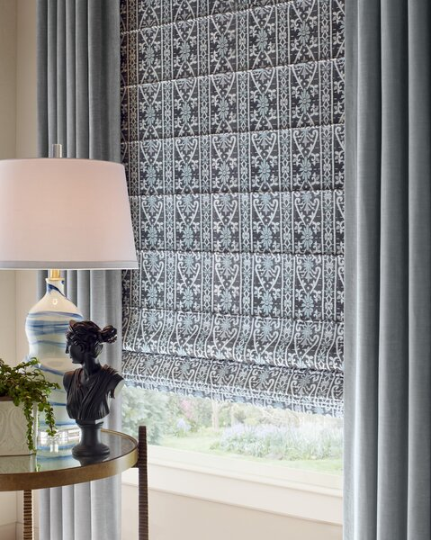 Giving new voice to historical designs, Marcie Bronkar envisioned fabrics with stylized patterns and nuanced colors, including Amaryllis (shown as a roman shade).
