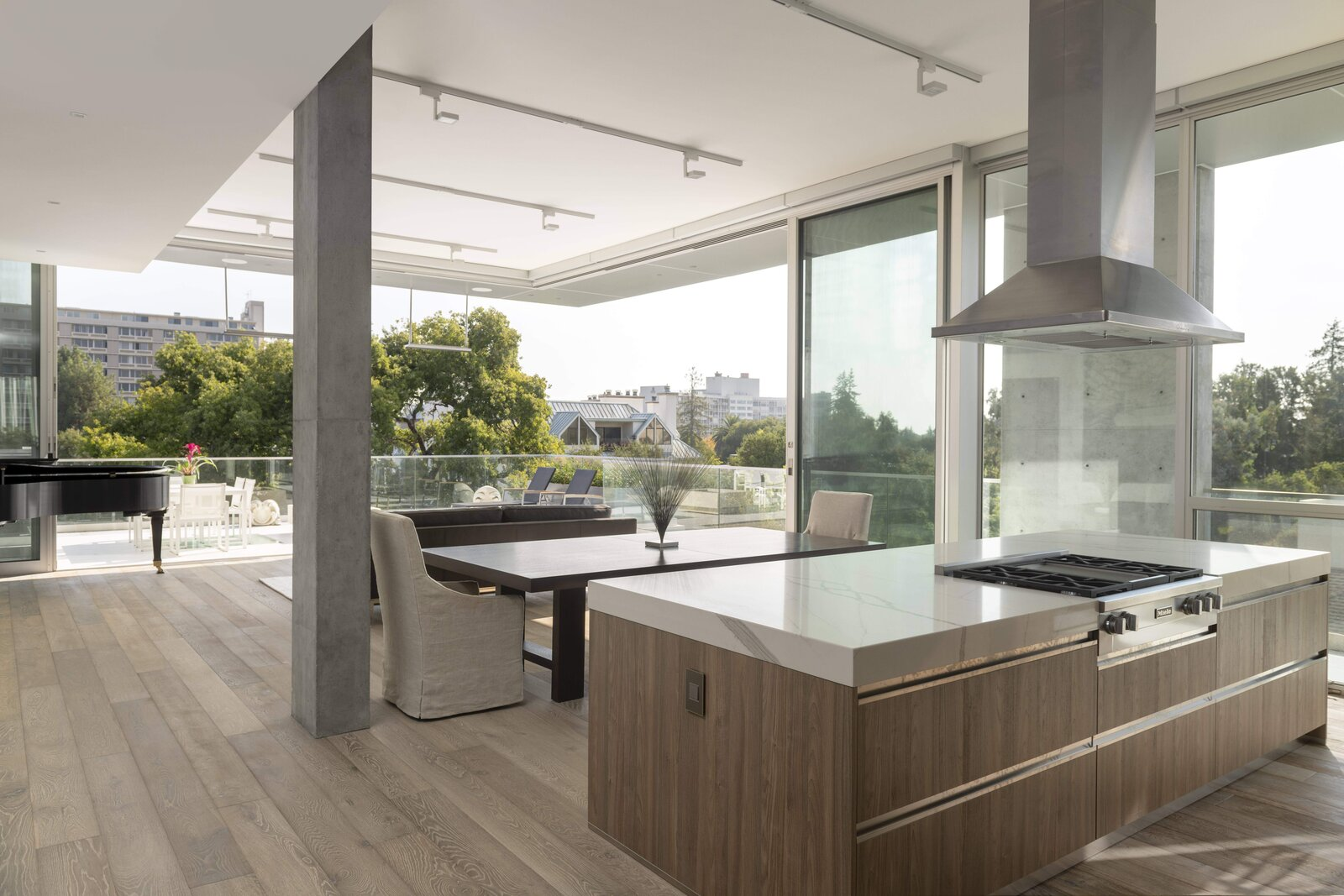 Inside, opening living spaces flow outdoors onto private decks.  Photo 4 of 7 in A Net-Zero Building in Silicon Valley Gracefully Encompasses Both Work and Play