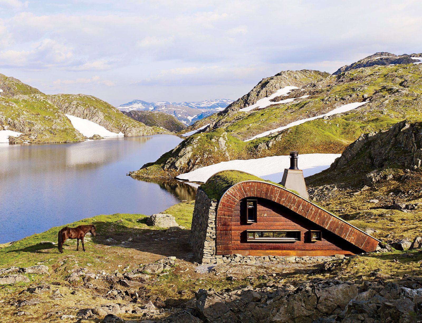 Exterior, Cabin Building Type, Curved RoofLine, Prefab Building Type, Green Roof Material, and Wood Siding Material The Bjellandsbu, a 376-square-foot hunting cabin located in western Norway. Designed by Snøhetta, Photo by James Silverman  #cabin #prefab #norway #horse #grassroof #snow  Photo 57 of 101 in 101 Best Modern Cabins from Cabins & Hideouts