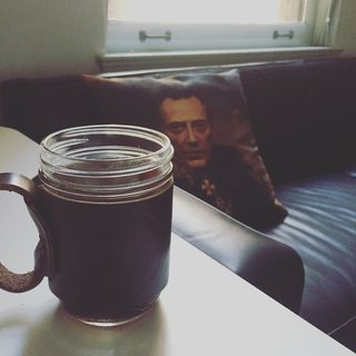 Hipster coffee mug. That pillow keeps watching me.
