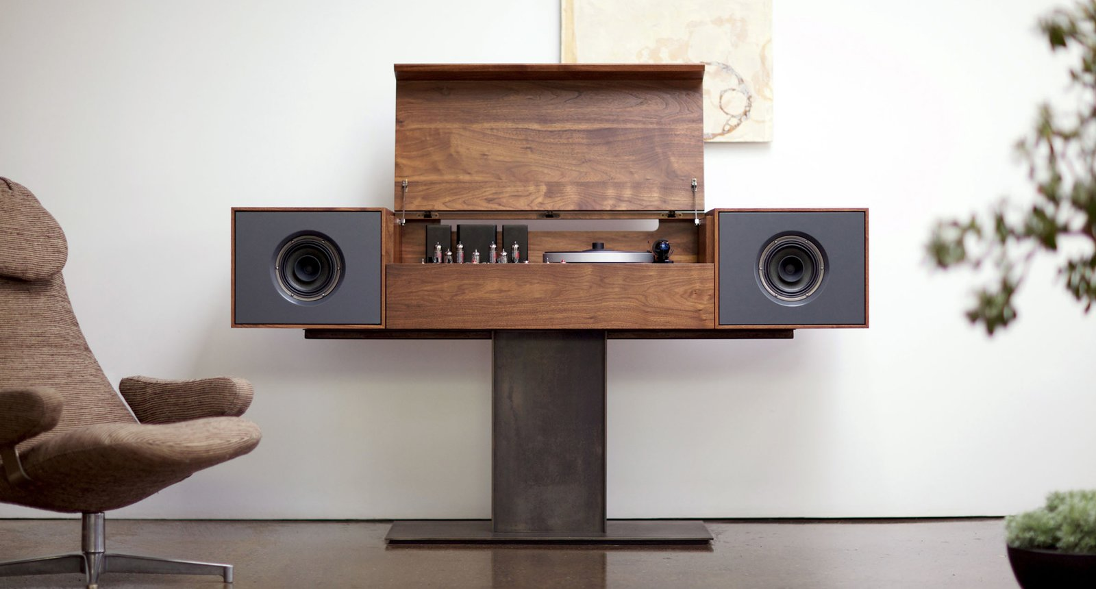 """The flagship of the Symbol audio line, the Modern Record Console pays homage to ""all in one"" console hifi's of the 1950's, an idea whose time, we believe, has come around again. Each cabinet is individually crafted in the tradition of fine bench-made furniture from solid American Walnut. The sculptural metal base is constructed from 1/4"" plate steel and hand patinated to create a warm natural finish. As a piece of furniture the MRC will undoubtedly become a focal point of any interior."" - SYMBOL audio Photo: Symbol Audio http://shop.symbolaudio.com/pages/modern-record-console  Sound Style"