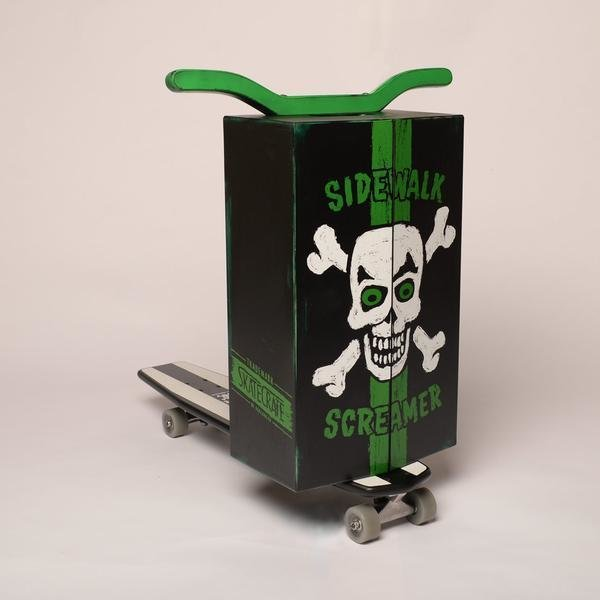 """Skate Crate: """"This is the black sheep of the Skate Crate family. This """"Land Pirate"""" design is sure to make people tremble in fear.  It features an """"aged"""" paint job with green trim and painted green upturned handle bars (not shown), and a carrying handle on top. """" http://skate-crate.myshopify.com/  Modern Skate"""