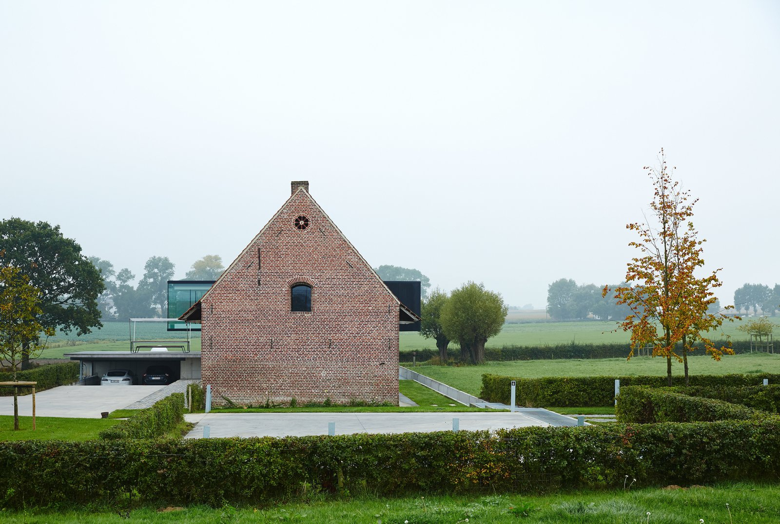 """Wynants grew up sailing, and he created the piece to suggest """"a moment of togetherness...the way one might gather at the back of the boat, to talk and drink."""" A side view of the house captures a glimpse of what he calls """"the monolith.""""  Wynant House"""