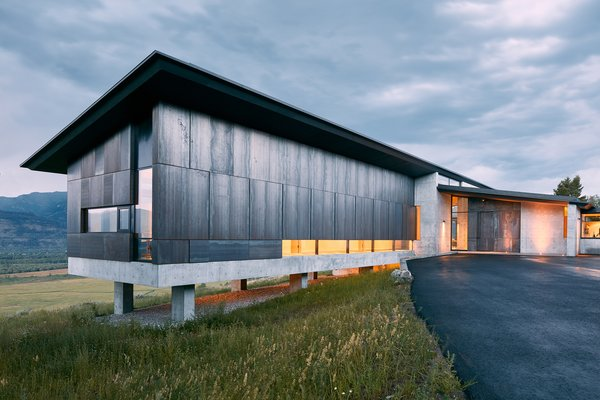 Cor-Ten steel acts as the primary exterior material.  Subtle design features in the steel paneling of the guest wing create notable results; every other panel is slightly offset to create visual and unexpected interest.