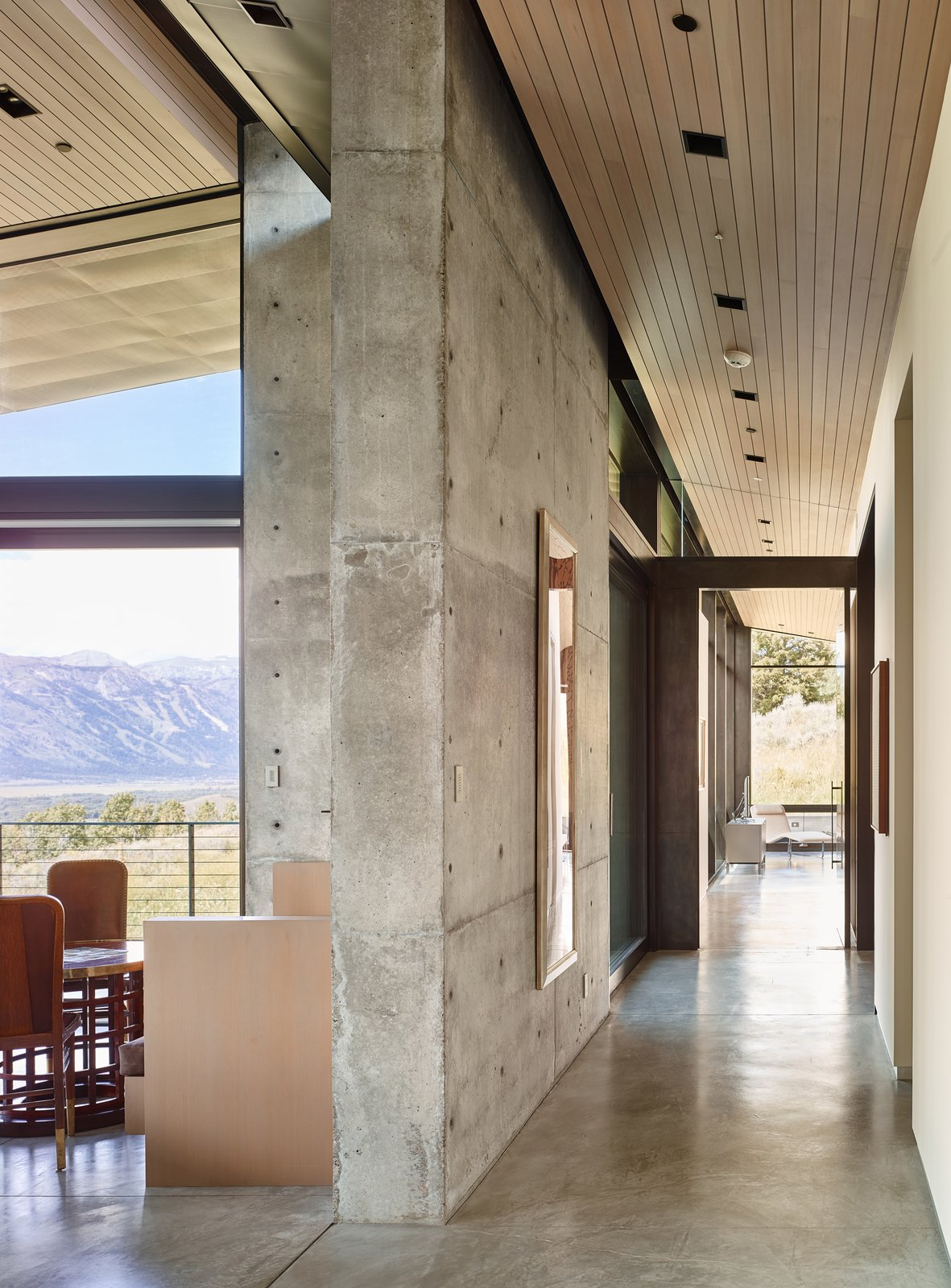 Once inside, natural light serves as an important material layered amongst its solid counterparts. Wood ceilings sit slightly pulled back from the walls to create a feeling of expansiveness.  Tagged: Hallway and Concrete Floor.  Wyoming Residence by Abramson Teiger Architects