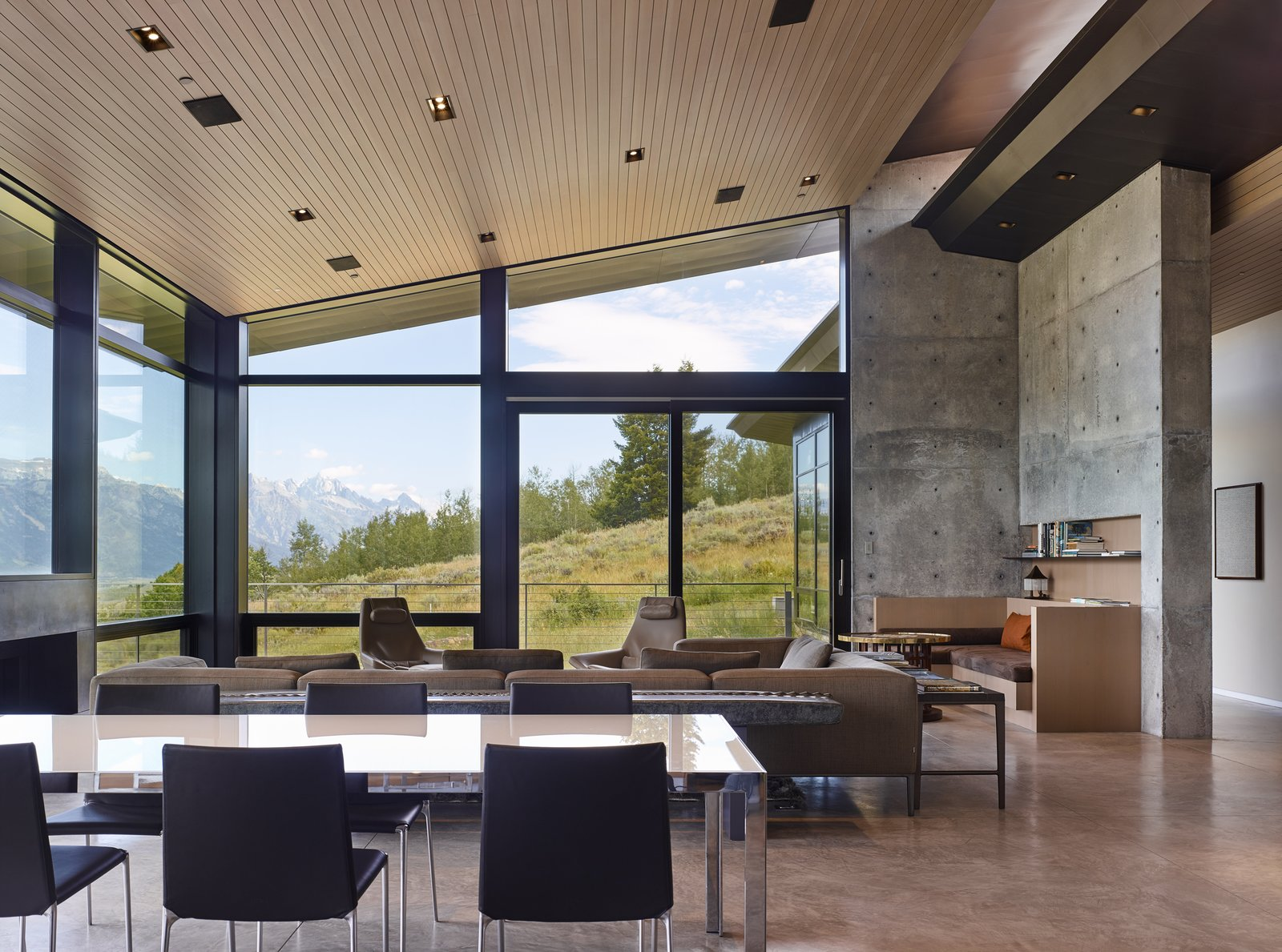 Dining Room, Chair, Table, Recessed Lighting, Standard Layout Fireplace, and Concrete Floor Floor-to-ceiling windows unveil a view of the stunning exterior scenery.  Wyoming Residence by Abramson Teiger Architects