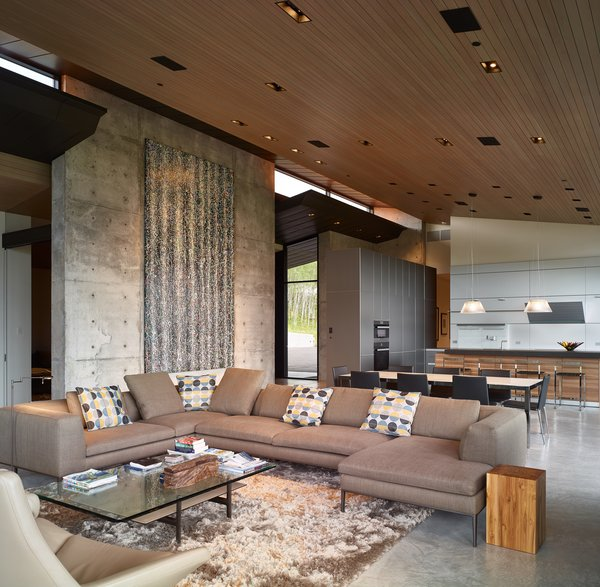 Living Room, Sectional, Concrete Floor, Coffee Tables, End Tables, Recessed Lighting, and Rug Floor The living area is voluminous yet intimate.  A built-in seating nook maintains a direct view of the mountains, unobstructed by a low profile fireplace.  Wyoming Residence by Abramson Teiger Architects