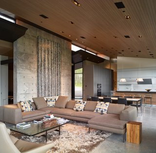 The living area is voluminous yet intimate.  A built-in seating nook maintains a direct view of the mountains, unobstructed by a low profile fireplace.