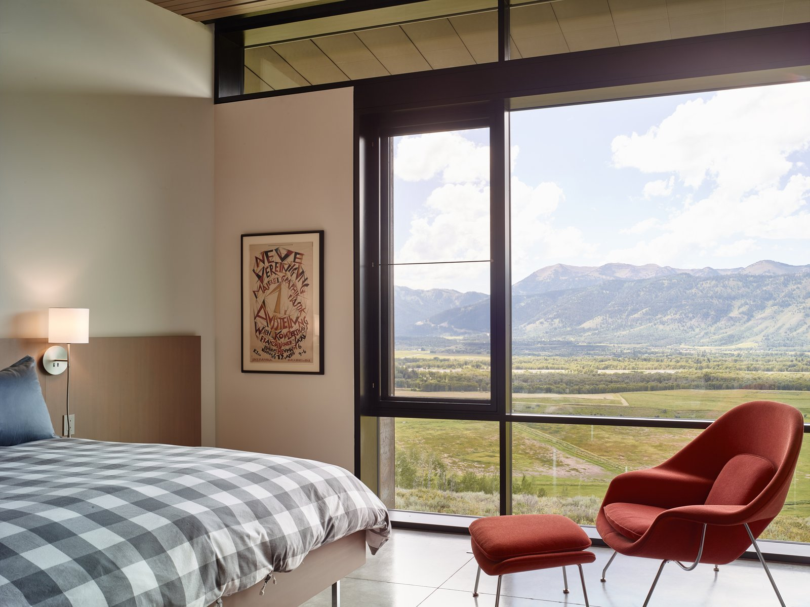 Bedroom, Bed, Chair, Concrete Floor, and Wall Lighting Windows in the guest bedrooms allow the ceiling to rest gently.   Wyoming Residence by Abramson Teiger Architects
