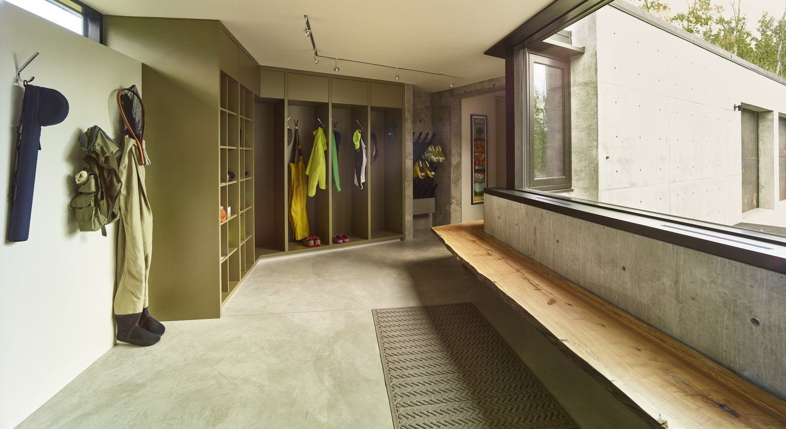 Storage Room, Closet Storage Type, and Shelves Storage Type A utilitarian mudroom features built-in storage, ski boot warmers, and a solid wood bench.  Photo 4 of 11 in 11 Ways to Create a Modern Mudroom in Your Home from Wyoming Residence