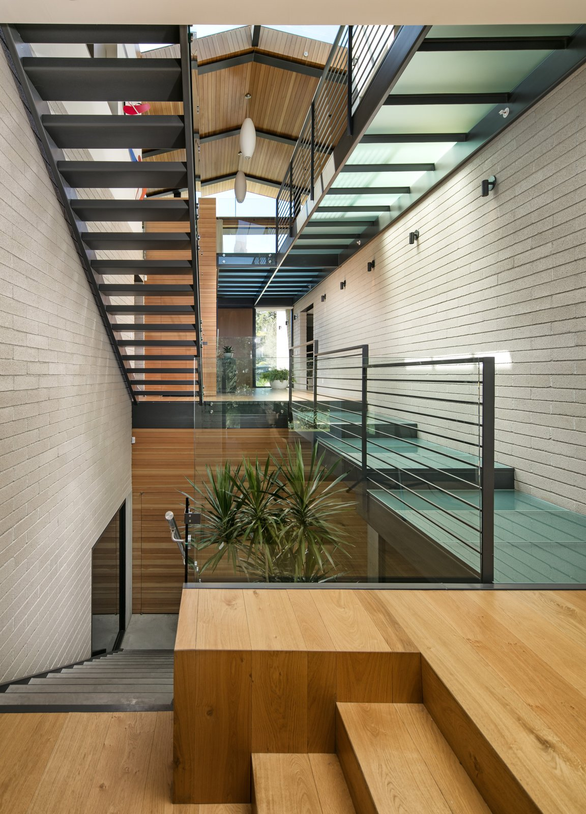 Glass is a prominent material used throughout the residence, seen from the very top of the structure in the form of expansive skylights and layered all the way down through the various levels of walkways.  Not only does this articulate volume, but it also allows the natural light to stream through all levels of the home.  Cohen Residence by Abramson Teiger Architects