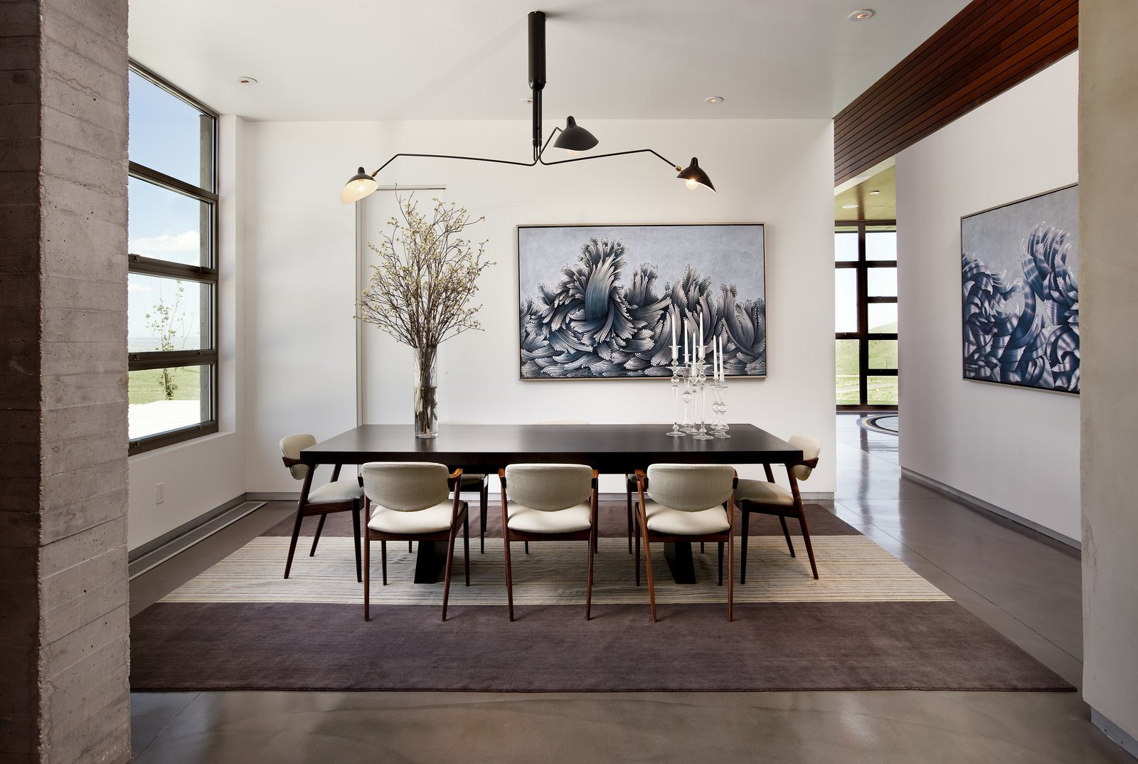 A striking dining room weaves Mid-Century with a classic sophistication.   Casper Residence by Abramson Teiger Architects