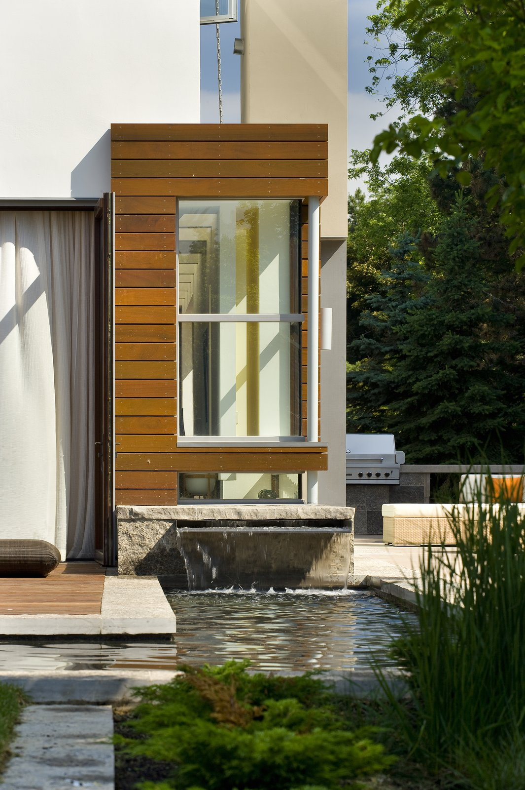 A water feature allows the patio and garden to float lightly.    Davis Residence by Abramson Teiger Architects