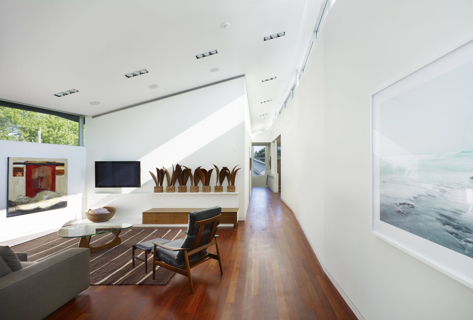 A tranquil seating area showcases the client's art and Mid-Century furniture classics.   Davis Residence by Abramson Teiger Architects