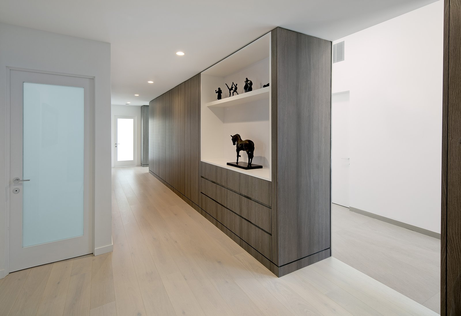 The color palette and grey wood finishes are carried throughout the home for a clean consistency.   Glenhaven Residence by Abramson Teiger Architects