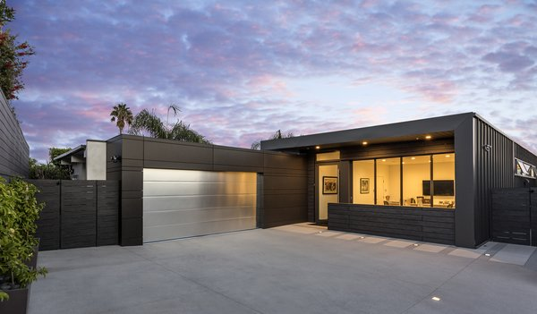 Exterior materials were selected for their desired low maintenance; Trespa, Swiss Pearl, and metal siding wrap the facade and create a refined, simple, modern look.  Glenhaven Residence by Abramson Teiger Architects
