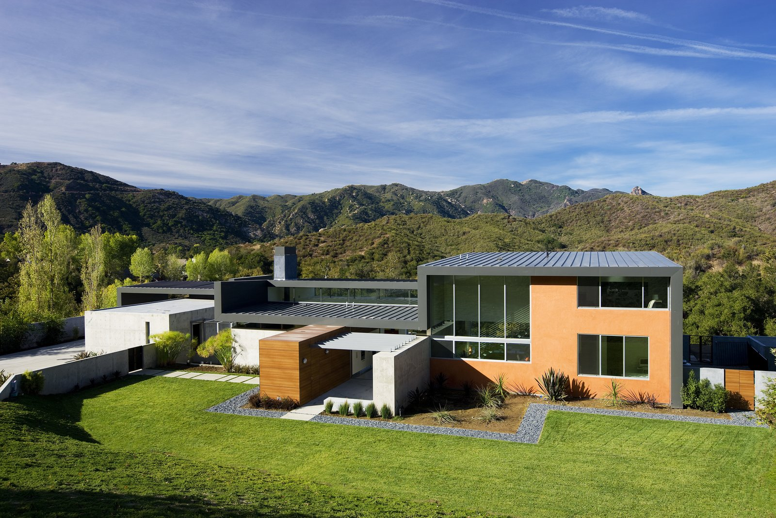 The compound consists of the main house building and the garage and guest room building, which are separated by a courtyard.   Lima Residence by Abramson Teiger Architects
