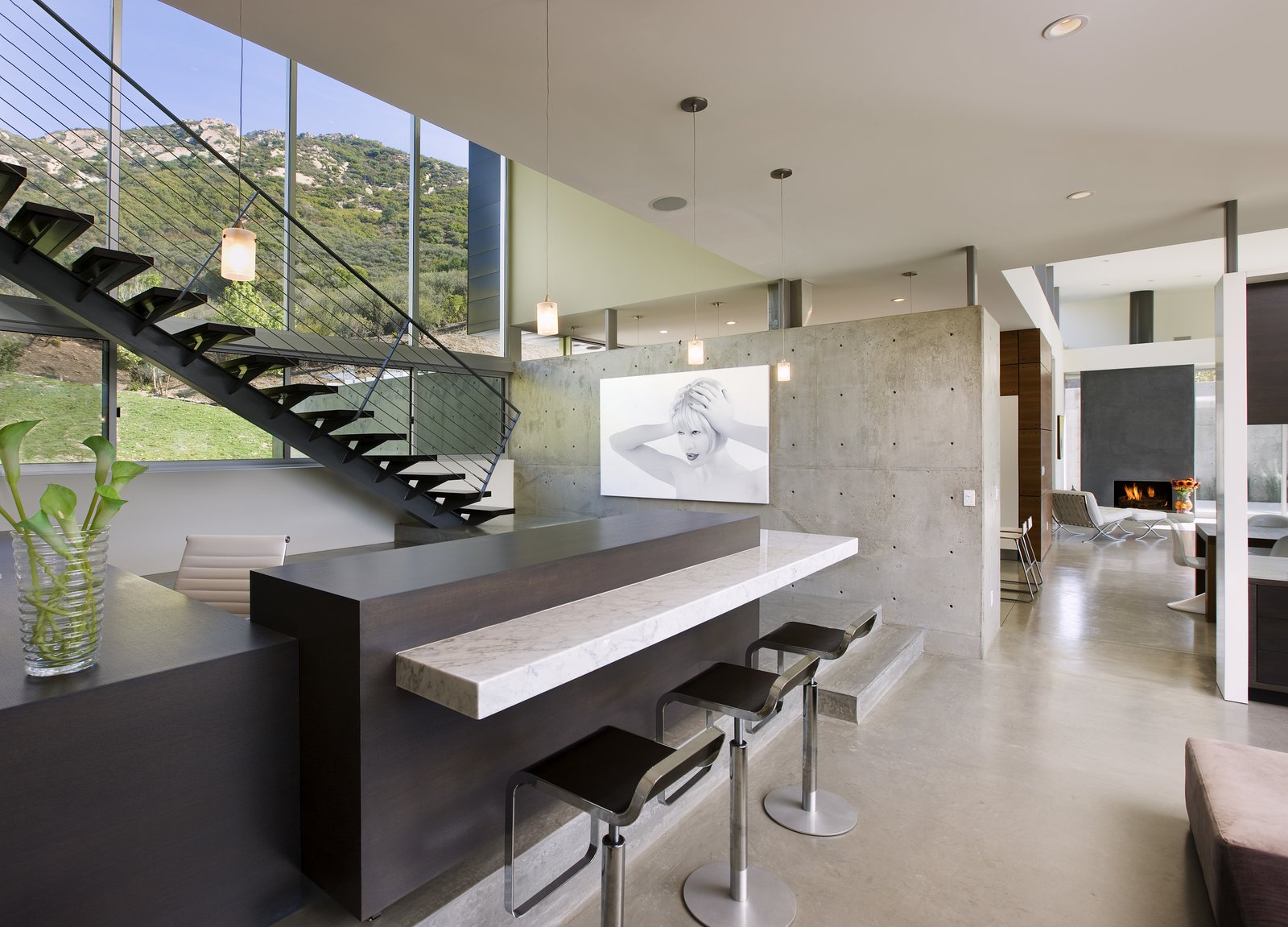 Concrete walls add an industrial touch to the polished home.   Lima Residence by Abramson Teiger Architects