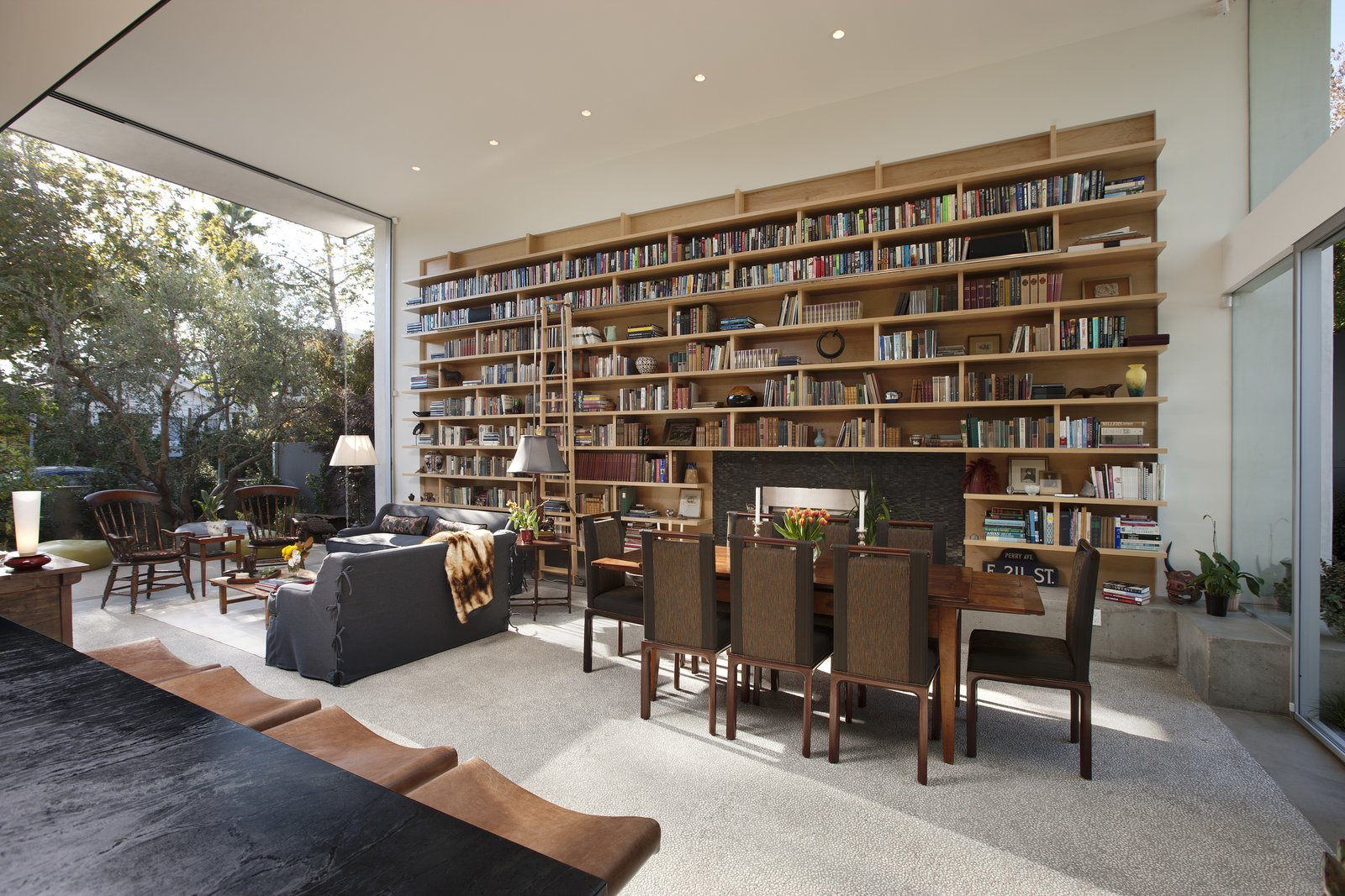 The homeowner possessed a brilliant collection of books, which are showcased in sprawling built-in book shelves in the living room.    Goodman Residence by Abramson Teiger Architects