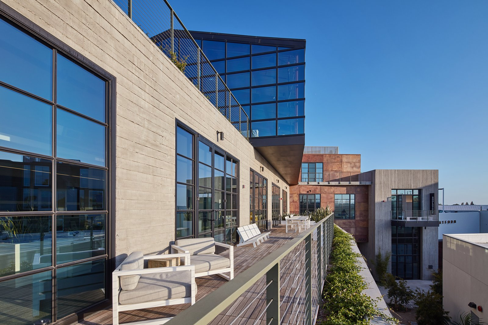 The design of the event space on the top floor was inspired by a greenhouse.  If you think about the abandoned box car site, you can also picture that over time, plants began to grow over.  The greenhouse space is a reinvention of this concept, represented in a form that houses a physical space.    PLATFORM by Abramson Teiger Architects
