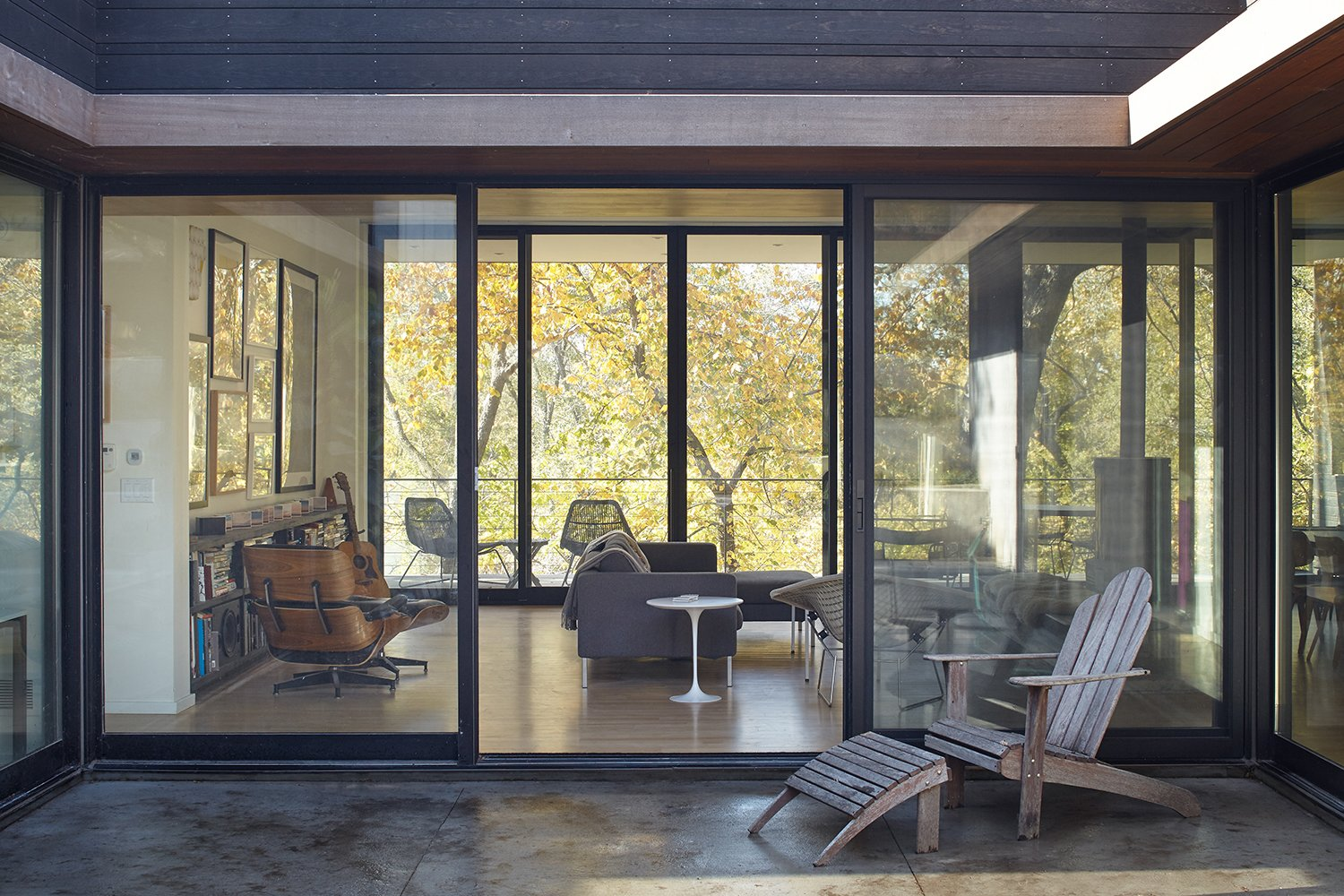Outdoor, Large Patio, Porch, Deck, and Concrete Patio, Porch, Deck Large sliding doors connect the living room to both the courtyard and a covered porch on the western side of the house.  Photo 5 of 9 in Nature Reigns Supreme at a Verdant Kansas City Home