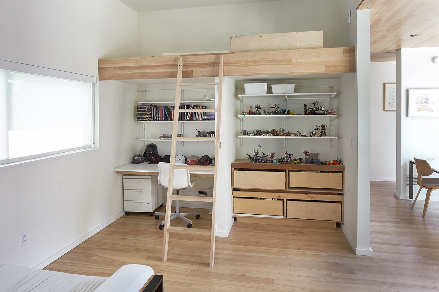 Kids Room, Light Hardwood Floor, Bed, Bedroom Room Type, and Desk The kids' bedrooms feature custom bunk beds with homework stations underneath.  Photo 8 of 9 in Nature Reigns Supreme at a Verdant Kansas City Home