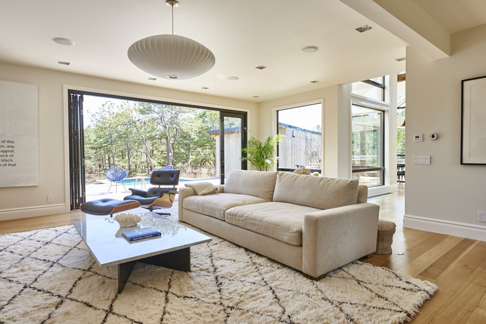 Living Room, Recliner, Sofa, Coffee Tables, and Pendant Lighting Solid white oak flooring is installed throughout. The home's windows and doors are by Andersen Windows.  Living Rooms by Dwell from You Won't Lose Your Wi-Fi Connection at This Hamptons Retreat