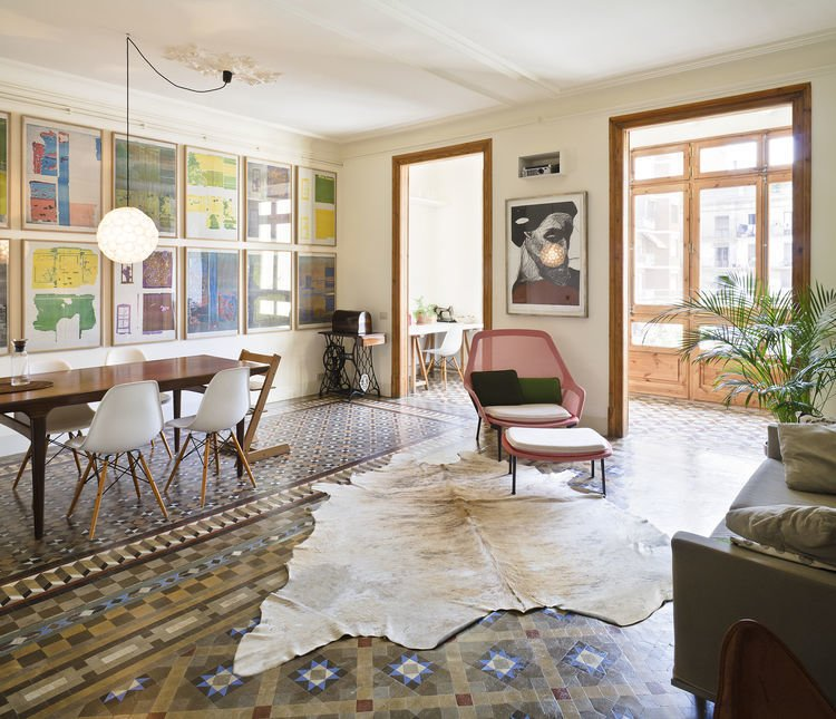 Living Room, End Tables, Chair, Table, Ceramic Tile Floor, Pendant Lighting, Ottomans, Rug Floor, and Sofa Dwell, March 2015; Historic Details and Playful Modernism Meet in this Stunning Barcelona Flat  Eames Molded Chairs from Crazy for Pattern
