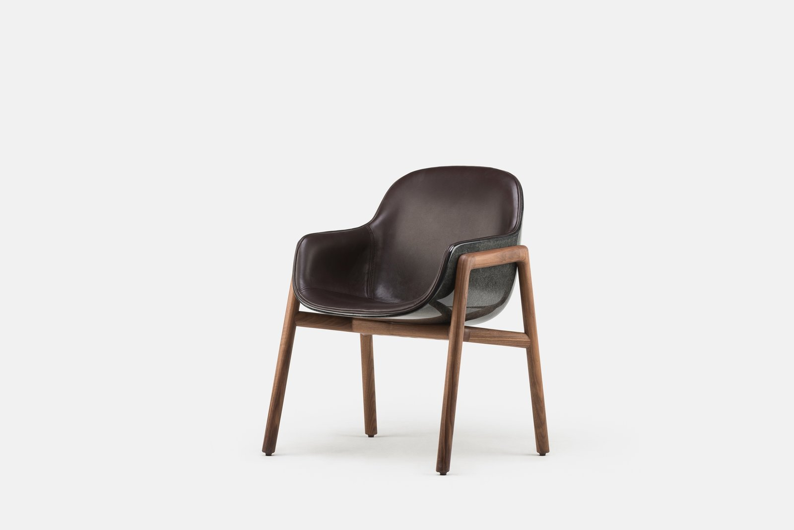 Along with the black-on-black option shown here, the Stella Armchair is also available in white, with the option to have either color in a glossy or matte finish. For additional freedom, the inner upholstery can be done in various different kinds of fabric or leather, while the base can be fitted with American black walnut (as shown here) or a lighter European ash.  Photo 3 of 8 in Bringing Back a Forgotten Material