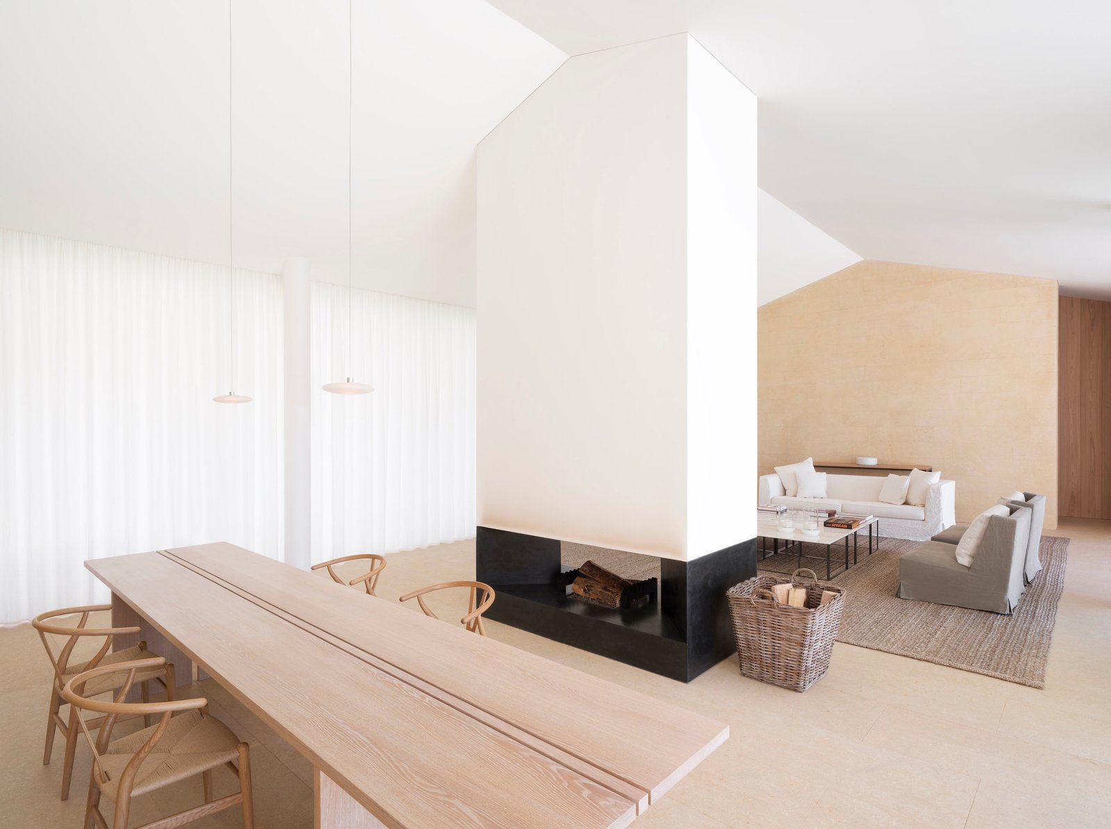 Nestled in the private residential estate of Les Parcs de Saint Tropez, this contemporary home was created by the London-based minimalist designer, John Pawson. Clean lines and bright white walls frame the freestanding fireplace, making for a dynamic open living space where the fireplace acts as the heart of the room.  97+ Modern Fireplace Ideas from Proof That a Modern Fireplace Can Be the Defining Factor of a Space