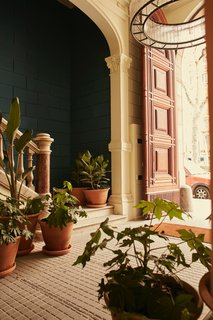 In the main corridor of the refreshed 19th century building, you'll find original mosaic floors and lush potted plants from Alejandra Coll of Asilvestrada Plants.