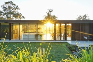Located in Queensland, Australia, the residence was created by Sarah Waller Design, an architectural studio that's based in the Queensland suburb of Doonan. The glass pavilion–style home was designed for Sarah Waller and her family and sits on top of a polished concrete slab. Inspired by the midcentury era, it looks out to the Noosa Valley golf course.