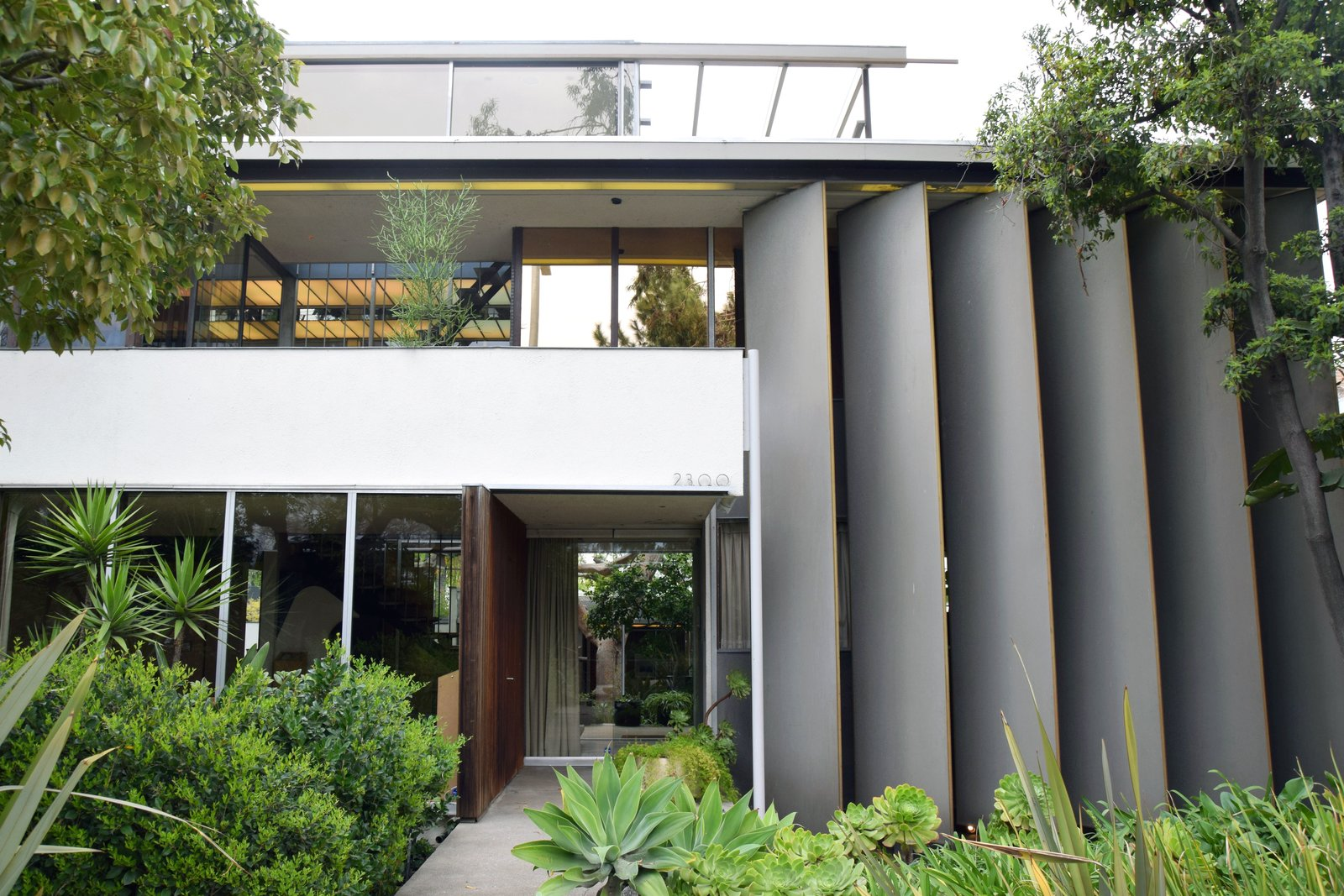 The main house of VDL II is made up of a series of modern lines and planes, which makes it stand out as one of Neutra's more eccentric designs. His use of reflective surfaces make it feel more expansive than it actually is, and plays off of the continued utilization of water throughout the property.  Photo 2 of 11 in Iconic Perspectives: Richard Neutra's VDL Studio & Residences