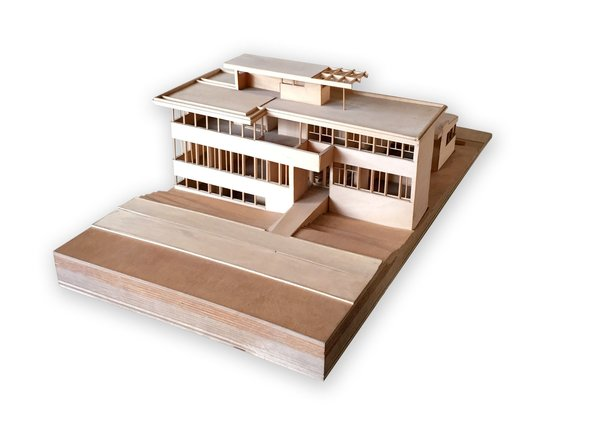 Perched on a piano towards the front of the house is a wooden model that was developed by Cal Poly Pomona students. It illustrates the original VDL residence design before it was destroyed in the 1963 fire. The piano it sits on belonged to Neutra's wife Dione where she would regularly play and sing. Neutra had cut off the original legs and replaced them with chromed tubular legs for a more modern look.  Photo 5 of 11 in Iconic Perspectives: Richard Neutra's VDL Studio & Residences
