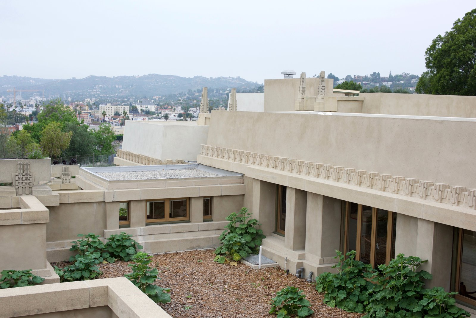 In an attempt to create a strong connection to nature, Wright incorporated outdoor sleeping porches onto all five of the bays. This was an experimental and forward-thinking practice that both Richard Neutra and Rudolph Schindler also incorporated into their Los Angeles designs.  Photo 4 of 14 in Iconic Perspectives: Frank Lloyd Wright's Hollyhock House