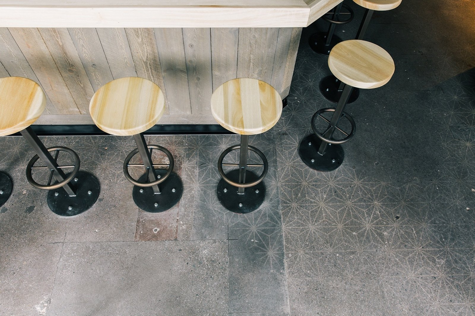 """Customers are given the freedom to seat themselves with a """"self-regulating line"""" concept. The floors feature a subtle stencil pattern that's finished with a weathered texture.  Photo 5 of 5 in The Classic Hand Roll Bar Makes a Comeback at a New Los Angeles Sushi Spot"""
