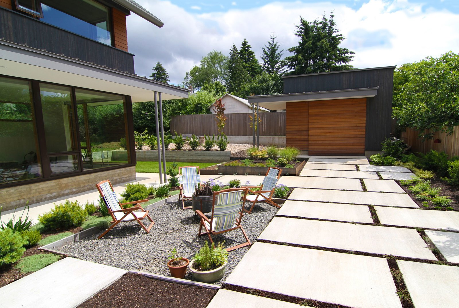Shown here is the exterior private courtyard, where McClellan and Williams did their own landscaping.  house pics from Dwell Home Tours Makes its Way to Portland