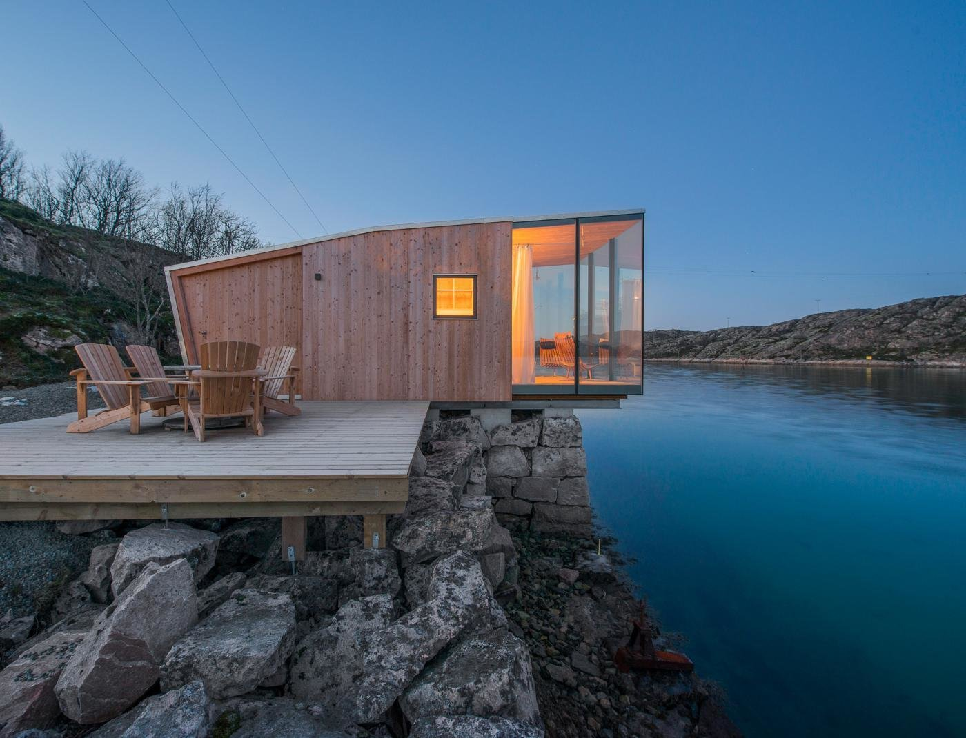 Small, Wood, Exterior, Wood, House, and Glass The cabins are made up of two layers of wood construction. The exterior layer is made of Larch wood with a custom glazing.  Best Exterior Wood Small Photos from Have You Ever Wanted to Stay in a Norwegian Sea Cabin?