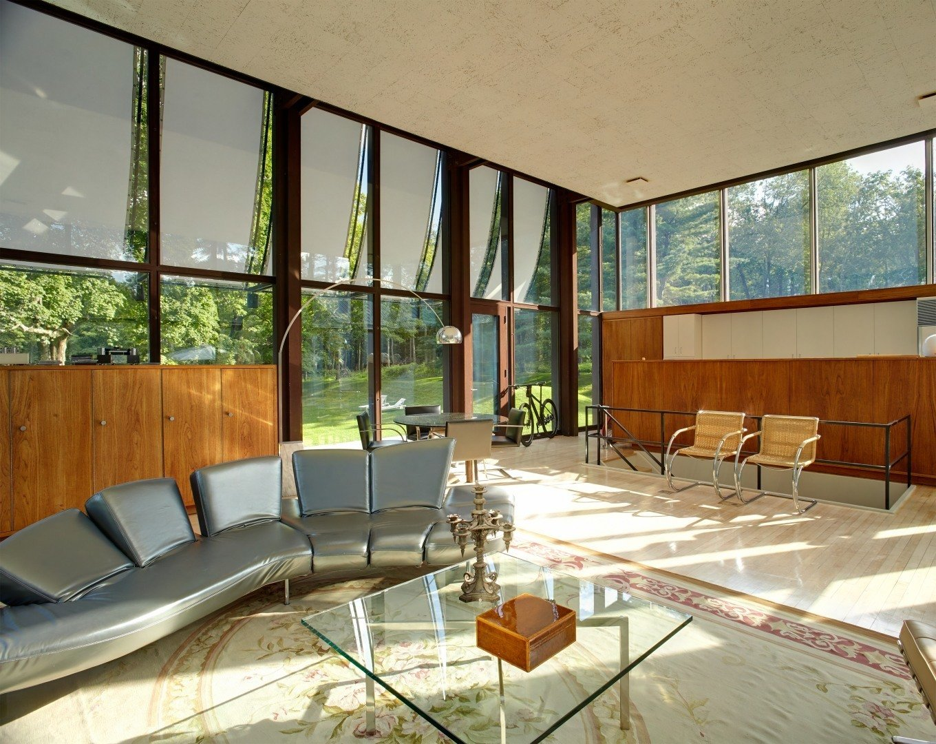 Since the large windows had gone through some harsh wear and tear over the years, Ferris decided to replace the old window panels with new double-paned windows while following Johnson's original drawings. Ferris personally knew Johnson and made sure to stick to his original vision when restoring the house.  Photo 7 of 10 in After a Year on the Market, Philip Johnson's Wiley House Drops by $2 Million