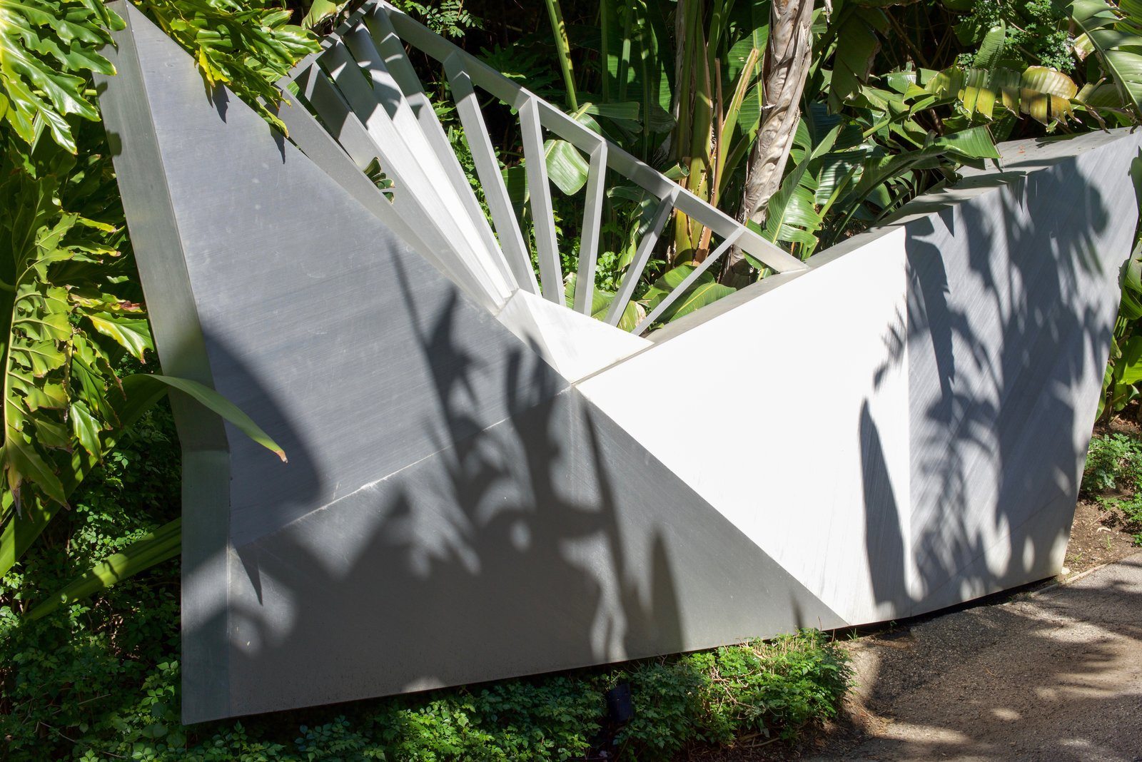 The long stroll down the driveway is lined with angular pieces of metalwork, like the one shown here.  Behind the Scenes at John Lautner's Sheats-Goldstein Residence