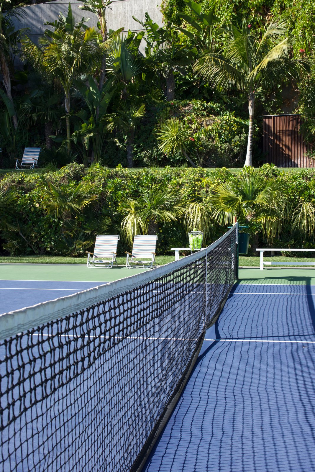 Goldstein regularly uses the tennis court, which has an upper level for visitors to watch and relax.  Behind the Scenes at John Lautner's Sheats-Goldstein Residence