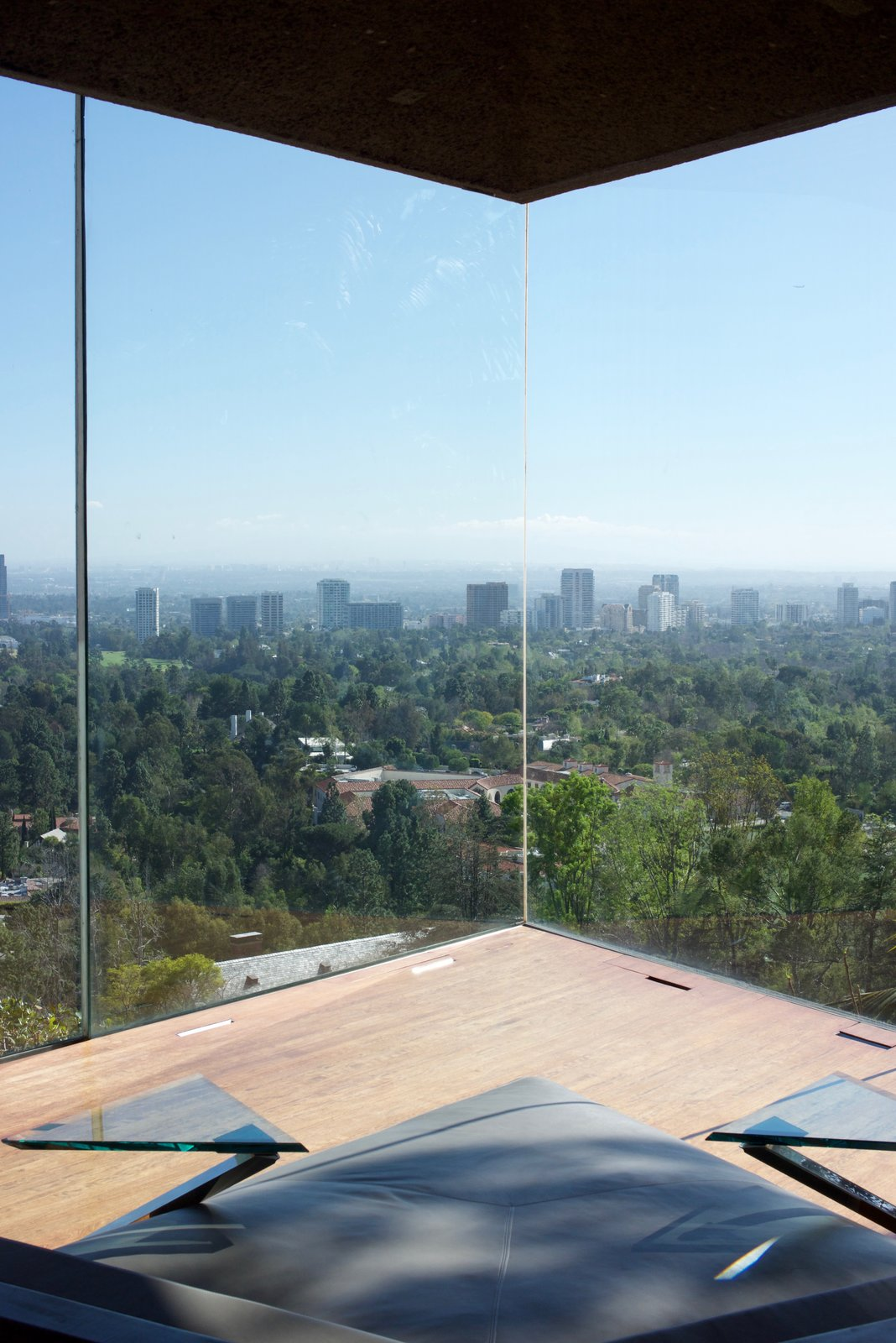 The bedroom holds custom gray leather lounging beds with angular side tables made of glass and steel.  Behind the Scenes at John Lautner's Sheats-Goldstein Residence