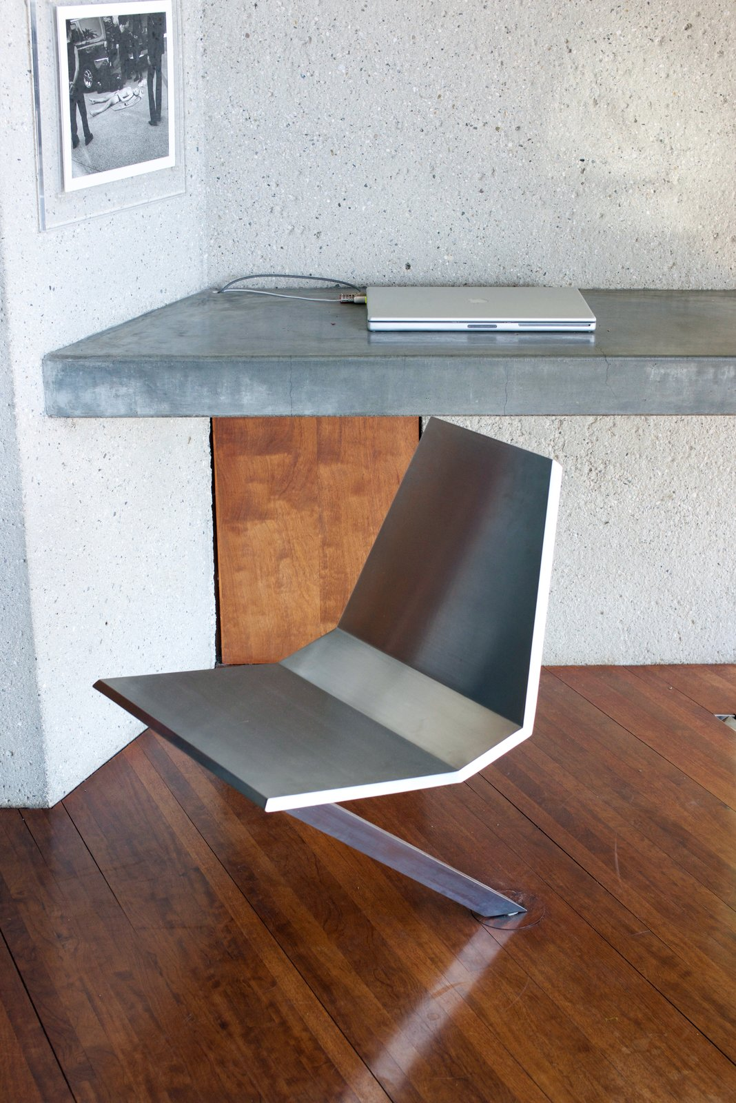 The stainless-steel swivel chair was made custom and rotates directly from the floor. It was designed by Lautner's protege, Duncan Nicholson—who helped oversee the renovations of the house.  Behind the Scenes at John Lautner's Sheats-Goldstein Residence
