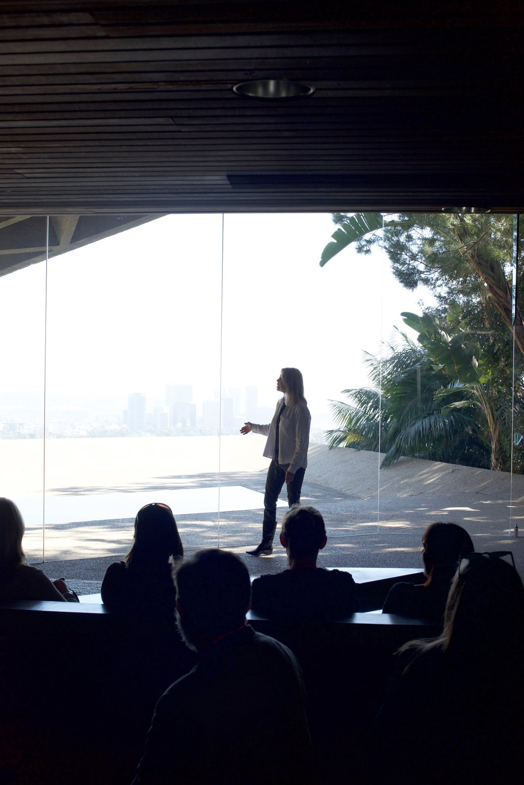James Goldstein's associate shared with the touring group the story of the house while standing in front of the pool.  Behind the Scenes at John Lautner's Sheats-Goldstein Residence